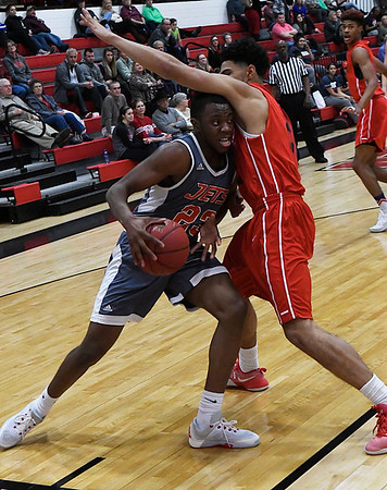 NOC Enid's Denzil Haynes tries to drive the baseline against Seminole's Kelly Kemp Thursday January 26, 2017 at the NOC Mabee Center. (Billy Hefton / Enid News & Eagle)