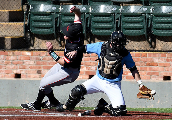 NOC Enid's Wade Hanska gets around SE Nebraska catcher Ross Lowe to score Saturday February 11, 2017 at David Allen Ballpark. (Billy Hefton / Enid News & Eagle)