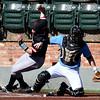 NOC Enid's Wade Hanska gets around SE Nebraska catcher Ross Lowe to score Saturday February 11, 2017 at David Allen Ballpark. (Billy Hefton / Enid News & Eagle)