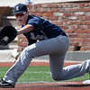 Enid's Braden Pierce stretches for a throw at first against Edmond North Saturday April 8, 2017 during the Gladys Winters Tournament at David Allen Ballpark. (Billy Hefton / Enid News & Eagle)