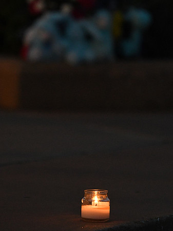A candle burns during a memorial service for Enid's Baby Boy Angel Friday April 14, 2017 at the Garfield County Courthouse gazebo. (Billy Hefton / Enid News & Eagle)