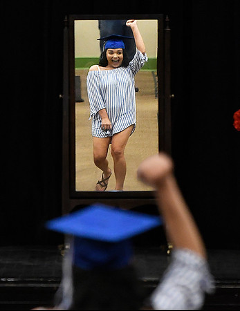 Lauryn Antilla pumps her fist as she leads the Lincoln Academy Survivors into the Emerson auditorium for Senior Appreciation Night Tuesday May 16, 2017. (Billy Hefton / Enid News & Eagle)