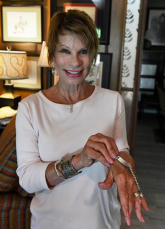 Cindy Benge show a family bracelet that was recently found after being lost for over 50 years. (Billy Hefton / Enid News & Eagle)
