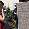 Courtney Shillington wipes her eyes as she reads the name of her husband, 1st Lt. Dale Shillington USAF during Memorial Day ceremonies at the Woodring Wall of Honor Monday May 29, 2017. (Billy Hefton / Enid News & Eagle)