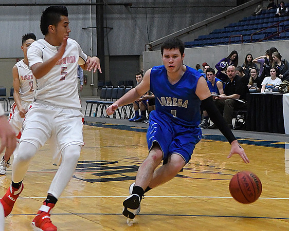 Lomega's Matthew Risenhoover dribbles away from Ringwood's Carlos Aguilar during the semi-finals of the Cherokee Conference Basketball Tournament Friday January 20, 2017 at the Chisholm Trail Expo Center. (Billy Hefton / Enid News & Eagle)