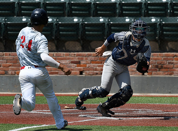 Enid Majors' Logan Rutledge runs down a wide throw as Richard Ware of the Albuquerque Cage Rats scores during an elimination game in the Connie Mack Regional Tournament Thursday July 20, 2017 at David Allen Memorial Ballpark. (Billy Hefton / Enid News & Eagle)