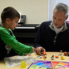 Curt Gilbertson works with Julian Camarena at the Carver Early Childhood Center Wednesday April 5, 2017. (Billy Hefton / Enid News & Eagle)