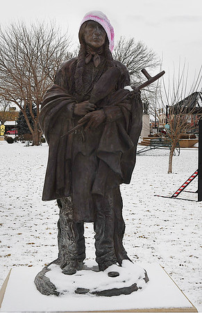 "The Harold Holden sclupture ""Keeper of the Plains"" wearing a knitted hat Friday January 6, 2017. (Billy Hefton / Enid News & Eagle)"