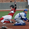 NOC Enid's Griffin Keller slides behind Pratt CC catcher, Clayton Beaver, to score Tuesday March 28, 2017 at David Allen Ballpark. (Billy Hefton / Enid News & Eagle)