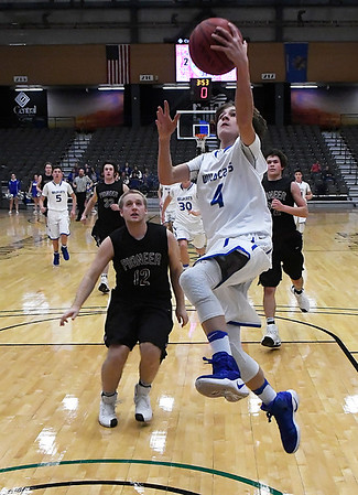 Tate Vrska of Covington-Douglas scores a fast break basket against Pioneer during the first round of the 93rd Skeltur Conference Basketball Tournament Tuesday January 17, 2017 at the Central National Bank Center. (Billy Hefton / Enid News & Eagle)