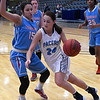 Enid's Izzy Plunkett drives towards the basket against Lawton Ike's Yuyi Pagan Saturday January 28, 2017 at the Central National Bank Center. (Billy Hefton / Enid Nedws & Eagle)