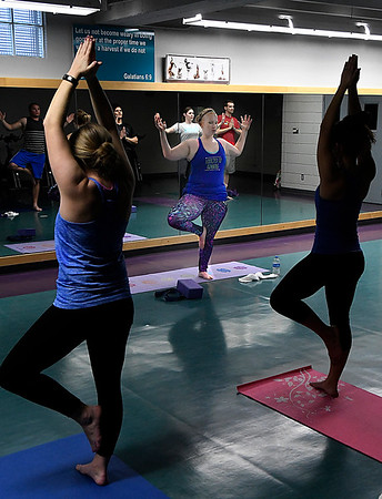 Meg Sandlin leads a yoga class at the Denny Price Family YMCA January 31, 2017. (Billy Hefton / Enid News & Eagle)