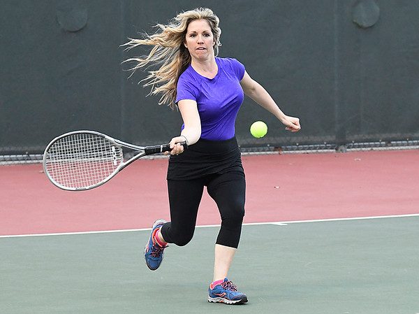 Sylvie Eaton returns a shot during the Enid Tennis Association play night at the Crosslin Park tennis courts Thursday April 20, 2017. (Billy Hefton / Enid News & Eagle)