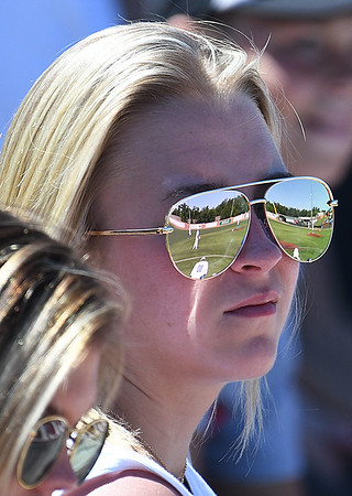 The field of David Allen Memorial Ballpark is reflected in the sunglasses of Kayley Lang during the 2017 NJCAA DII World Series Sunday May 28, 2017. (Billy Hefton / Enid News & Eagle)