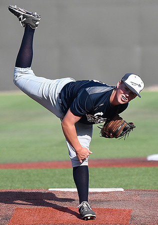 Enid Plainsmen, Brett Russell, follows through on a pitch against the OKC Indians during the opening day of the Connie Mack Regional Qualifing Tournament at David Allen Memorial Ballpark Wednesday June 14, 2017. (Billy Hefton / Enid News & Eagle)
