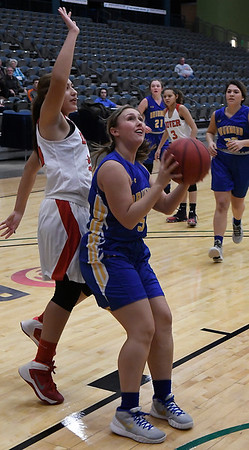 Dover's Cinthia Montes tries to block the shot of Drummond's Hannah Butler during the 93rd Skeltur Conference Basketball Tournament Wednesday 18, 2018 at the Central National Bank Center. (Billy Hefton / Enid News & Eagle)
