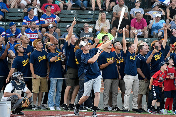 Phoenix CC players celebrate as Max Johnson hits a homerun in the homerun derby during the opening ceremonies of NJCAA World Series Friday May 26, 2017 at David Allem Memorial Ballpark. (Billy Hefton / Enid News & Eagle)