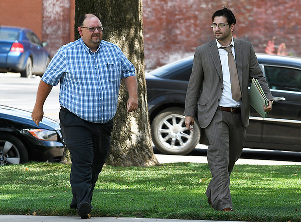 Garfield County sheriff, Jerry Niles, arrives at the Garfield County Courthouse with attorney, M. Eric Bayat, Tuesday July 25, 2017 where he was indicted on felony second-degree manslaughter in the death of an inmate at the Garfield County detention center last year. (Billy Hefton / Enid News & Eagle)