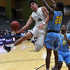 Enid's Orion Tafoya drives to the basket against Putnam City West's M.J. Warrior Tuesday February 14, 2017 at the Central National Bank Center. (Billy Hefton / Enid News & Eagle)