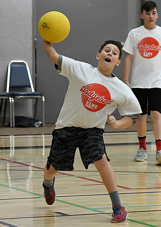 Holton Miller throws a ball during a KLife dodgeball tournament Saturday March 25, 2017 at Oakwood Christian Church. (Billy Hefton / Enid News & Eagle)