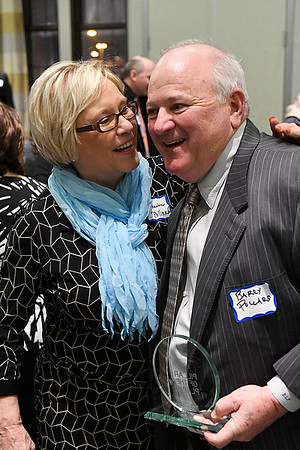 Dr. Barry Pollard is greeted by his wife, Roxanne, after being named 2016 Pillar of the Plains during a reception Thursday January 12, 2017 at the Central National Bank Center. (Billy Hefton / Enid News & Eagle)