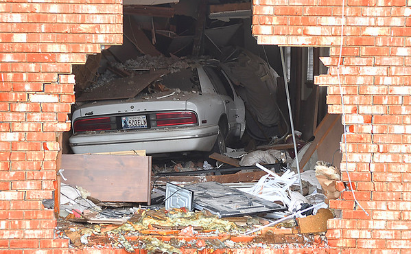 A car sits inside the house at 201 N. McKinley Wednesday January 18, 2017. (Billy Hefton / Enid News & Eagle)