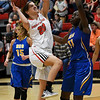 NOC Enid's McKenna Pulley drives the lane against Northeastern Oklahoma's Hatty Nawezhi Thursday February 23, 2017 at the NOC Mabee Center. (Billy Hefton / Enid News & Eagle)