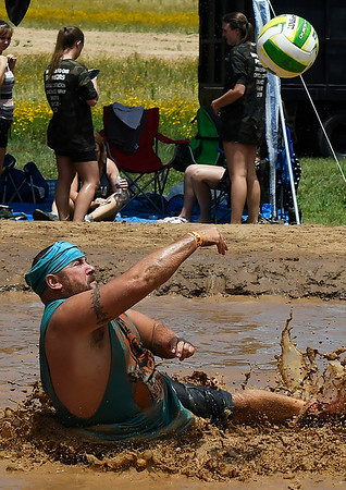 Justin Crites of the 50 Shades of Mud team fall as he returns the ball during the Miracle League Mud Volleyball Tournament Saturday June 24, 2017. (Billy Hefton / Enid News & Eagle)