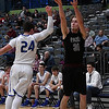 Pioneer's Aaron Gabriel shoots over Gavin Smith of Covington-Douglas during the first round of the 93rd Skeltur Conference Basketball Tournament Tuesday January 17, 2017 at the Central National Bank Center. (Billy Hefton / Enid News & Eagle)
