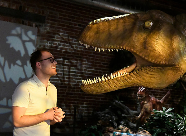 "Lewis Eggleston gets a close view of an acrocanthosaurus that is part of the exhibit ""Red Dirt Dinos: An Oklahoma Dinosaur Adventure,"" at Leonardo's Children's Museum. The exhibit runs through September and is included in the general admission. (Billy Hefton / Enid News & Eagle)"