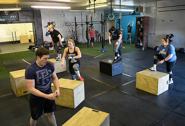 Men and women take part in a class at CrossFit ReFuel January 17, 2017. (Billy Hefton / Enid News & Eagle)