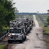 A line of utility repair trucks stage along Holden Road between Stabe and Sheridan Roads Wednesday May 3, 2017. (Billy Hefton / Enid News & Eagle)