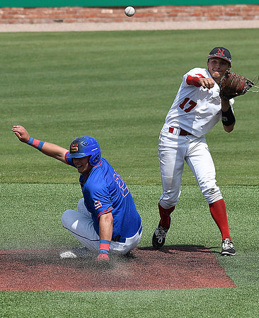 NOC Enid's T.J. Black throws over Troy Black of Murray State to complete a game ending double play during the Region 2 tournament Monday May 15, 2017 at David Allen Memorial Ballpark. (Billy Hefton / Enid News & Eagle)