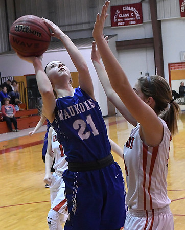 Waukomis' Makayla Conrady shoots over Ringwood's Kamryn Randolph Thursday February 2, 2016 at Ringwood HIgh School. (Billy Hefton / Enid News & Eagle)