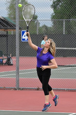 Sylvie Eaton serves during the Enid Tennis Association play night at the Crosslin Park tennis courts Thursday April 20, 2017. (Billy Hefton / Enid News & Eagle)
