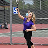Sylvie Eaton serves during the Enid Tennis Association play night at the Crosslin Park tennis courts Thursday April 20, 2017. (Billy Hefton / Enid News & Eagle)