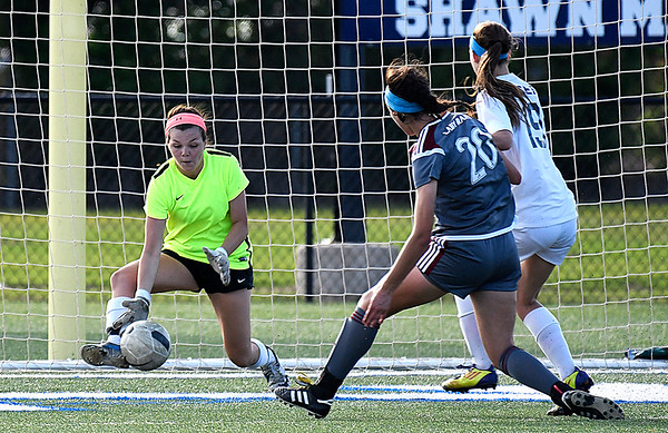 Enid goalkeeper, Mazzy Priest, makes a save against Owasso Friday April 14, 2014 at D. Bruce Selby Stadium. (Billy Hefton / Enid News & Eagle)
