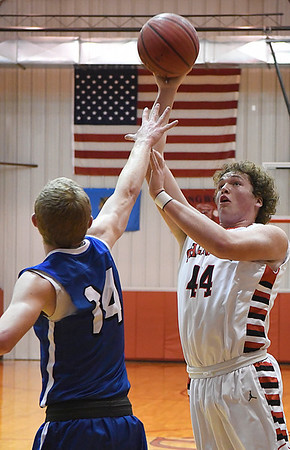 Cherokee's Blake Hall scores over Chris Henderson of Waukomis February 10, 2017 during the opening round of the district tournament at Ringwood High School. (Billy Hefton / Enid News & Eagle)
