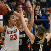 Fairview'sTanara Combs looks for an outlet while being pressured by Woodward'sMaty Moyer and Caylee Kline during the finals of the Wheat Capital Basketball Tournament Saturday January 7, 2017 at Chisholm High School. (Billy Hefton / Enid News & Eagle)