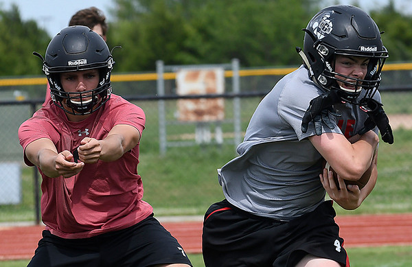 OBA's Jud Minx follows through on a fake after handing off to Traber Smithson during spring practice Friday May 19, 2017. (Billy Hefton / Enid News & Eagle)