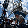 Isaac Perez does maintenance on the ferris wheel at Meadowlake Park Tuesday June 27, 2017 in preparation for the July 4 holiday. (Billy Hefton / Enid News & Eagle)