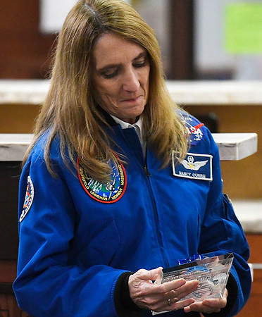 Dr. Nancy Currie-Gregg looks at a plaque presented to her during a dedication ceremony naming the observatory on top of Enid HIgh School the Dr. Nancy Currie-Gregg Observatory Tuesday February 28, 2017. (Billy Hefton / Enid News & Eagle)