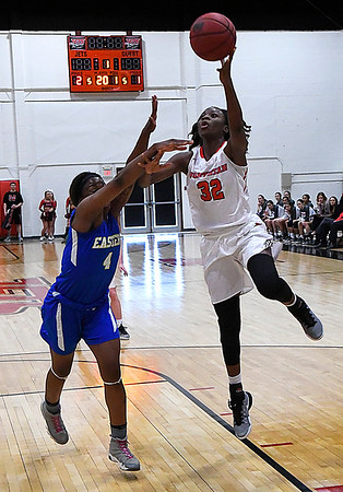 NOC Enid's Dossou Ndiaye shoots over Eastern'sJasmine Williams Thursday February 16, 2017 at the NOC Mabee Center. (Billy Hefton / Enid News & Eagle)