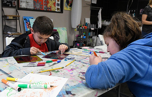 Isaiah and Veronica Purcell work on projects during after school lessons at Creatice Arts Enid Tuesday January 17, 2017. (Billy Hefton / Enid News & Eagle)