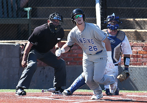 Lansing CC's Garrett Hammer watches the ball as it clears the fence for a 3-run walk off homerun in the bottom of the 9th inning to beat Murray State 11-9 in the 2017 NJCAA DII World Series Sunday May 28, 2017 at David Allen Memorial Ballpark. (Billy Hefton / Enid News & Eagle)