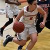 NOC Enid's Sarah Garvie drives towards the basket against Seminole's Torri Tarkington Thursday January 26, 2017 at the NOC Mabee Center. (Billy Hefton / Enid News & Eagle)
