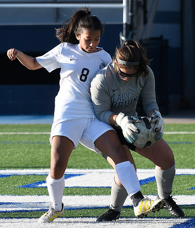 Enid's Franky Diaz challenges the Bartlesville goalkeeper Friday April 7, 2017 at D. Bruce Selby Stadium. (Billy Hefton / Enid News & Eagle)