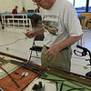 "Marty Hovey works on setting up his ""z"" scale display for the CSMRA Trainfest to be held this weekend at Oakwood Mall. The show will be open Saturday June 10 9 a.m. - 3 p.m. and Sunday June 10 a.m. - 3 p.m. (Billy Hefton / Enid News & Eagle)"