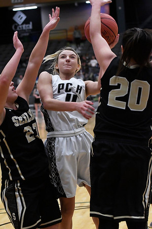 Pond Creek-Hunter's Brooke Rayner tries to get a shot over Seiling's Carly Gore and Macy Gore during the class A area tournament championship game Friday February 24, 2017 at the Central National Bank Center. (Billy Hefton / Enid News & Eagle)