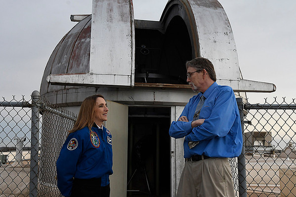 Dr. Nancy Currie-Gregg visit with Dusty Hugaboom in front of the of the observatory on top of Enid HIgh School prior to a dedication ceremony naming the observatory the Dr. Nancy Currie-Gregg Observatory Tuesday February 28, 2017. (Billy Hefton / Enid News & Eagle)